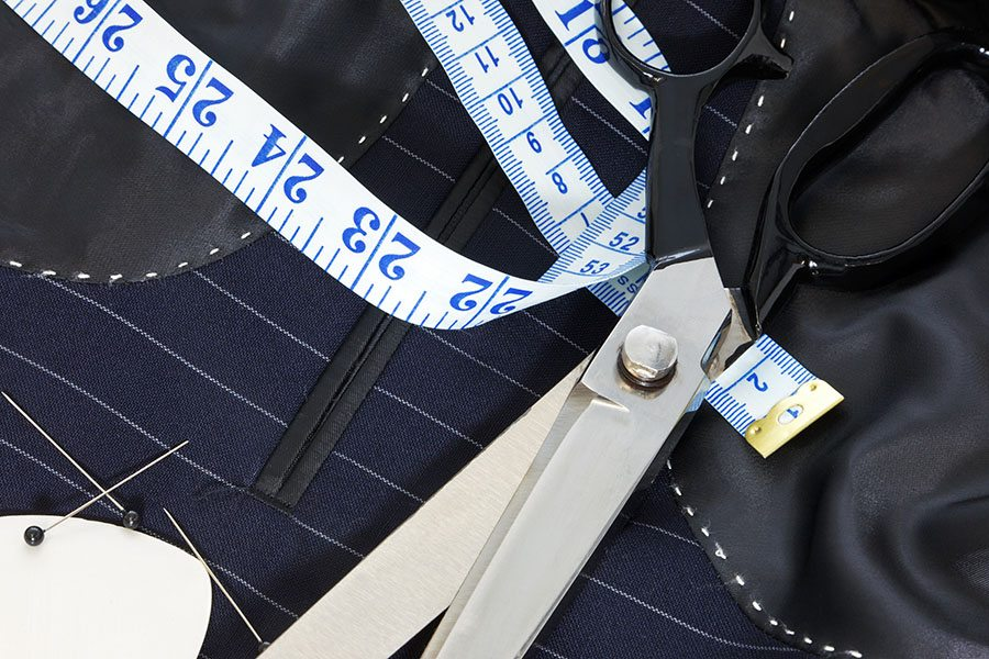 Professional Tailoring Tools Including Tape Measure, Scissors, Needles, and Thread